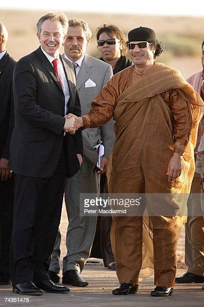 Prime Minister Tony Blair smiles as he shakes hands with Colonel Muammar Abu Minyar alGaddafi on May 29 2007 in Sirte Libya Mr Blair is on a five day...