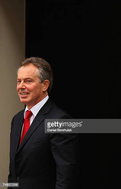 Prime Minister Tony Blair stands at the door before leaving his Downing Street residence for the last time as Prime Minister on June 27 2007 in...