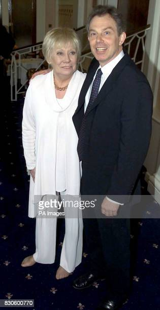 Prime Minister Tony Blair stands next to shoeless actress Liz Dawn at the Womens Achievement Awards in Leeds Just before he made his speech at the...