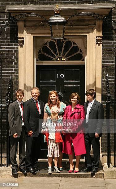 Prime Minister Tony Blair stands with his family Euan Kathryn Leo Cherie and Nicky as he leaves Downing Street for the last time on June 27 2007 in...