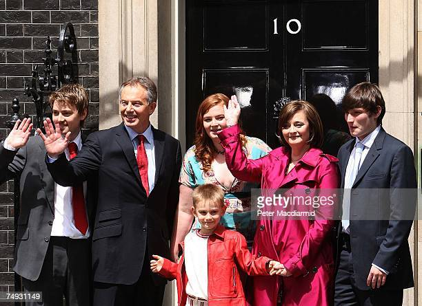 Prime Minister Tony Blair stands with his family Euan Kathryn Leo Cherie and Nicholas as he leaves Downing Street for the last time on June 27 2007...