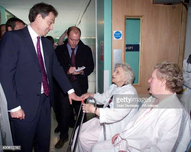 Prime Minister Tony Blair talks to patients Mrs Doris Benedict and Mrs Kathleen Herd during a visit to the Pilgrim Hospital in Boston Lincolnshire...