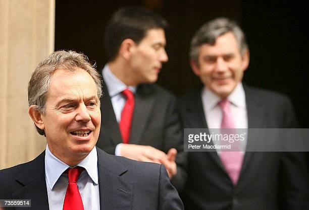 Prime Minister Tony Blair walks out of the number 10 door followed by Chancellor Gordon Brown and Environment Secretary David Milliband in Downing...