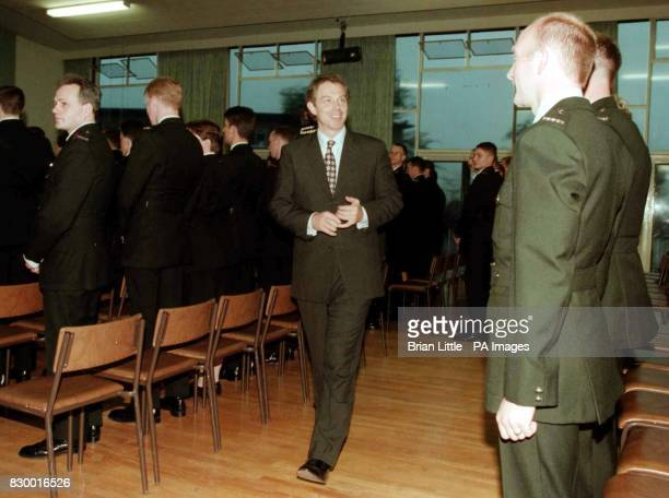 Prime Minister Tony Blair walks through the ranks of trainee policemen at RUC training centre at Garnerville East Belfasttonight Photo by Brian...