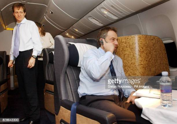 Prime Minister Tony Blair watched by his Director of Communications and Strategy Alastair Campbell speaks to the Foreign Secretary Jack Straw on the...