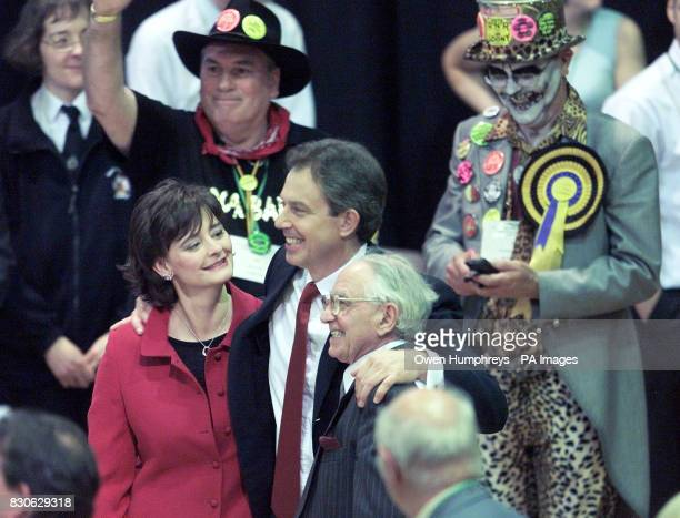 Prime Minister Tony Blair with members of the Monster Raving Loony Party behind him gives his wife Cherie and father Leo a hug after being declared...