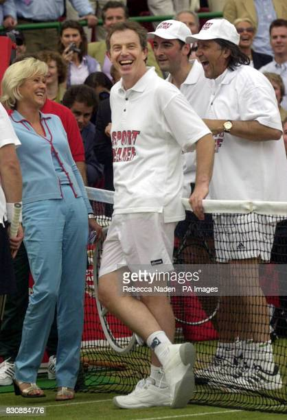 Prime Minister Tony Blair with TV presenter Sue Barker comedian Alistair McGowan and former Romanian player Ilie Nastase after a tennis match for...