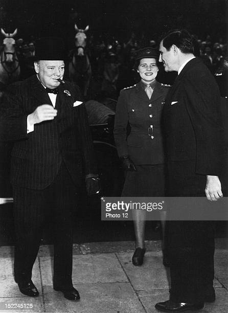 Prime Minister Winston Churchill and his daughter Captain Mary Churchill of the ATS visit US Ambassador John G Winant at the American Embassy in...