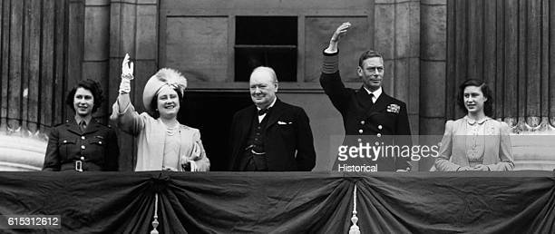 Prime Minister Winston Churchill appears on the balcony at Buckingham Palace together with King George VI and Queen Elizabeth and the two princesses...