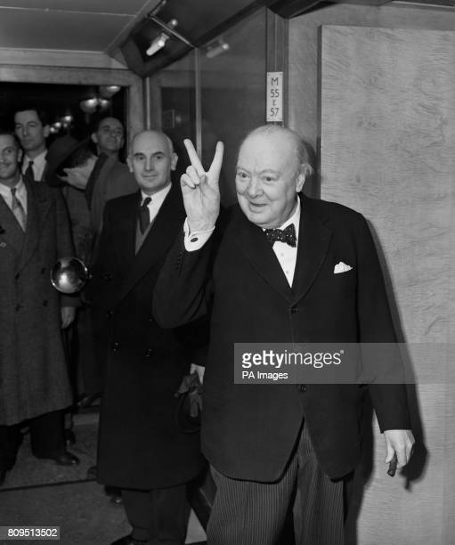 Prime Minister Winston Churchill gives a 'victory' sign whilst on board the Cunard liner RMS Queen Mary on which he was sailing to New York