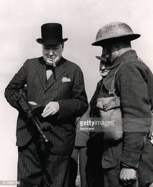 Prime Minister Winston Churchill inspects an American Tommy gun during a 1940 tour of defenses along England's northeastern coast