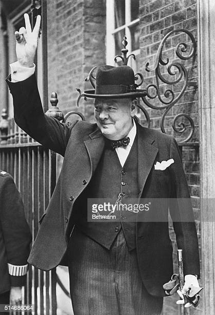 Prime Minister Winston Churchill makes the victory sign upon returning from a trip to Washington DC and North Africa