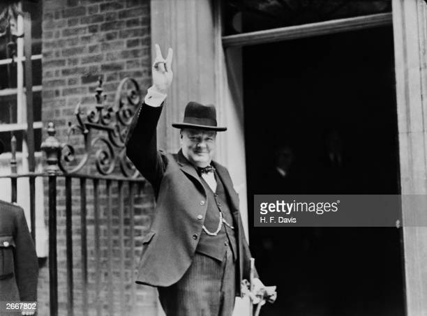 Prime Minister Winston Churchill outside 10 Downing Street gesturing his famous 'V for Victory' hand signal London June 1943