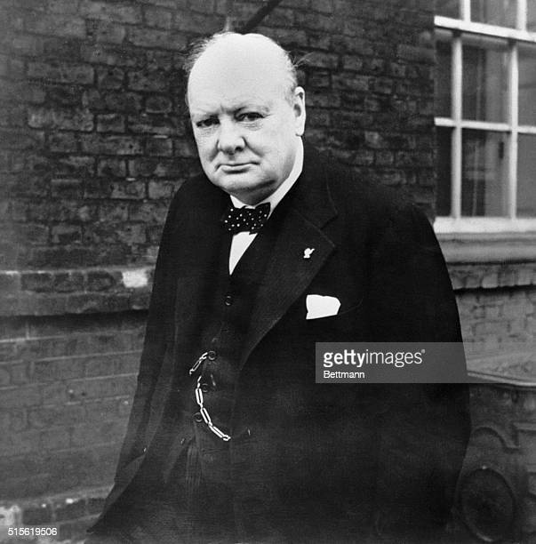 Prime Minister Winston Churchill wearing a thumbs up lapel pin at 10 Downing Street, during World War II.