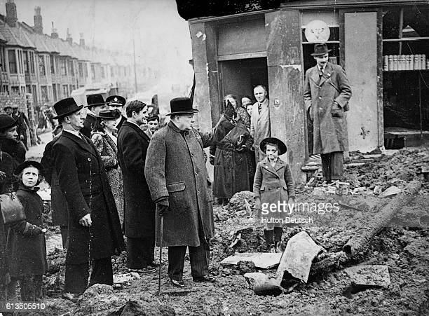 Prime Minister Winston Churchill with his wife and the American ambassador visits the bombed city of Bristol England in April 1941