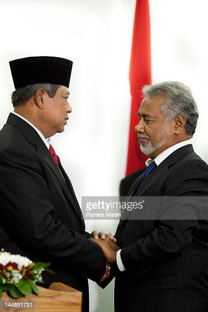 Prime Minister Xanana Gusmao shakes hands with the President of Indonesia Susilo Bambang Yudhoyono at a press conference at the Government Palace as...
