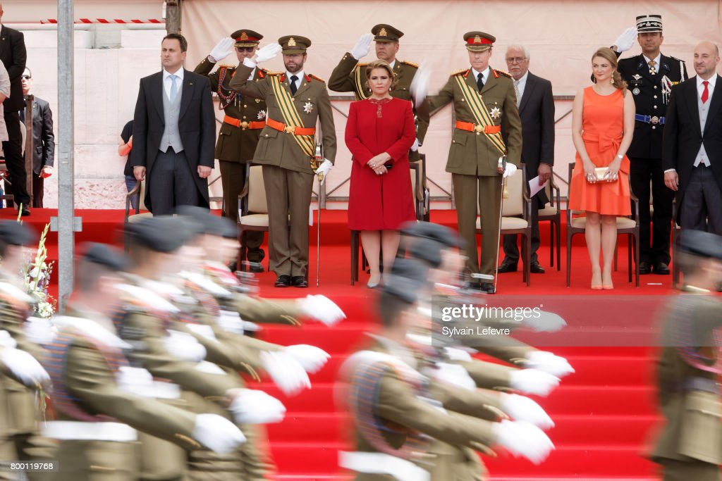 Prime Minister Xavier Bettel, Prince Guillaume of Luxembourg, Grand Duchess Maria Teresa of Luxembourg, Grand Duke Henri of Luxembourg, Princess Stephanie and Defense Minister Etienne Scneider attend National Day parade on June 23, 2017 in Luxembourg, Luxembourg.