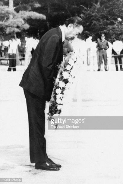 Prime Minister Yasuhiro Nakasone offers a wreath during the peace memorial ceremony on 38th anniversary of the Hiroshima ABomb dropping at Hiroshima...