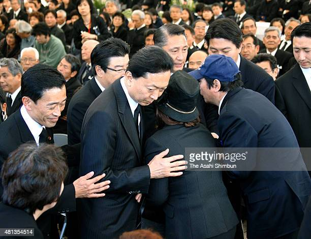 Prime Minister Yukio Hatoyama hugs Minamata disease patients during the MInamata Disease Victims Memorial Service on May 1 2010 in Minamata Kumamoto...