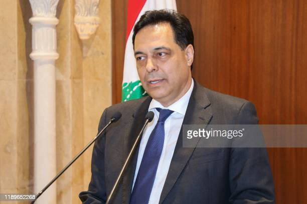 Prime Ministerdesignate Hassan Diab gives a statement following his meeting with outgoing prime Minister Saad Hariri in Beirut on December 20 2019...