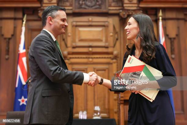 Prime Ministerdesignate Jacinda Ardern and Green Party leader James Shaw shake hands during a confidence and supply agreement signing at Parliament...