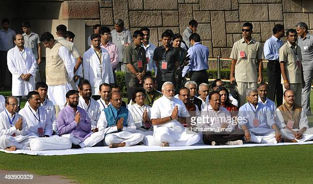 Prime Ministerdesignate Narendra Modi sitting in prayer meeting with BJP workers after paying respects at Rajghat the memorial of Mahatma Gandhi...