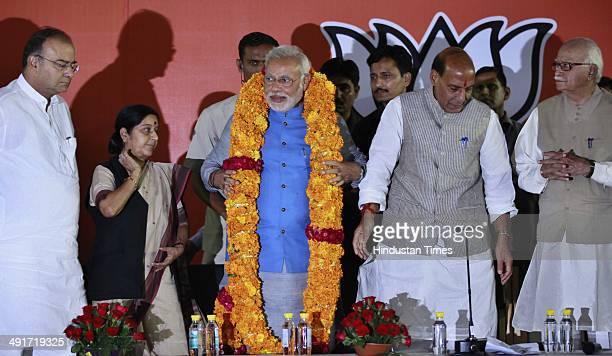 BJP prime ministerial candidate Narendra Modi along with BJP president Rajnath Singh and party senior leaders Arun Jaitely Sushma Swaraj and LK...