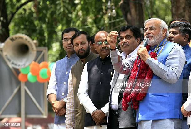 BJP prime ministerial candidate Narendra Modi along with party senior leaders arrive to attend BJP parliament board meeting after his party's...