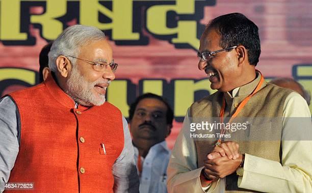 BJP prime ministerial candidate Narendra Modi and Madhya Pradesh Chief Minister Shivraj Singh Chauhan at the BJP National Executive Meeting at...