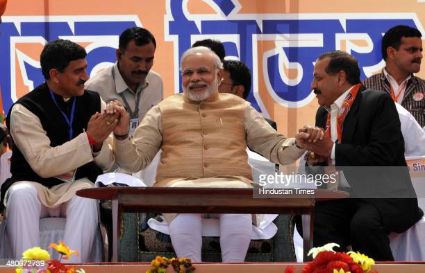 BJP prime ministerial candidate Narendra Modi conversating with both Bhartiya Janta Party nominated candidates for upcoming Parliamentry elections...