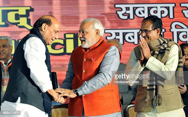 Prime Ministerial candidate Narendra Modi president Rajnath Singh and Madhya Pradesh Chief Minister Shivraj Singh Chauhan at the BJP National...