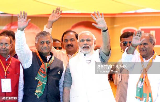 Prime Ministerial candidate Narendra Modi with Ghaziabad candidate and former Indian Army Chief VK Singh Gautam Budh Nagar candidate Mahesh Sharma...