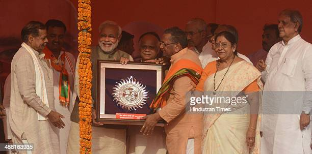 BJP prime ministerial candidate Narendra Modi with local BJP leaders during an election rally at Parade ground on May 4 2014 in Allahabad India Modi...