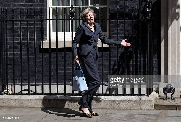 Prime Minister-in-waiting, Theresa May, reacts to photographers after walking to the wrong car after attending a Cabinet meeting at Downing Street on...