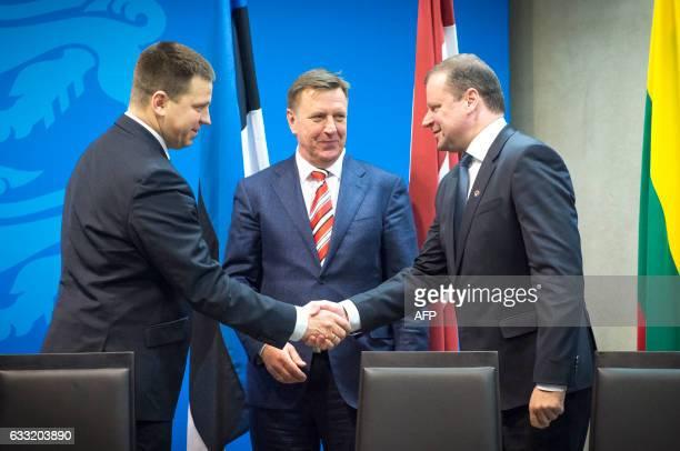 Prime ministers Juri Ratas of Estonia, Maris Kucinskis of Latvia, Saulius Skvernelis of Lithuania, shake hands after signing a trilateral agreement...