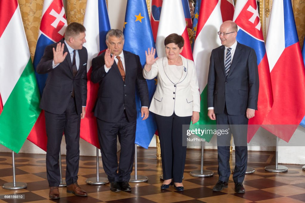 Prime Ministers of Visegrad Group countries (L-R): Slovakia's Robert Fico, Hungary's Viktor Orban, Poland's Beata Szydlo and Czech Republic's Bohuslav Sobotka shake hands during their meeting at the Royal Castle in Warsaw, Poland on 19 June 2017