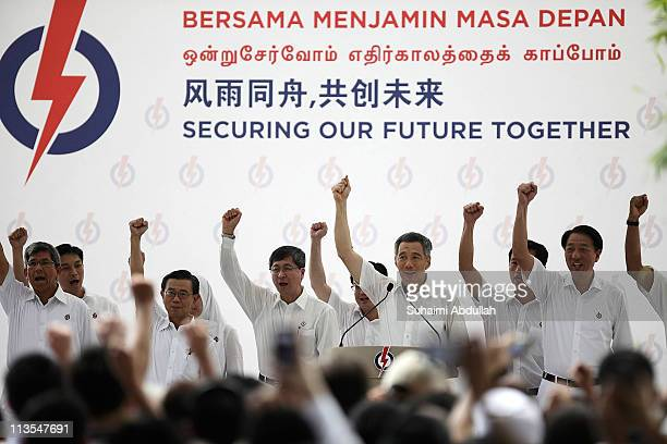 Prime Minster and the Secretary General of the People's Action Party Lee Hsien Loong leads the cheer Majulah PAP Majulah Singapura together with the...