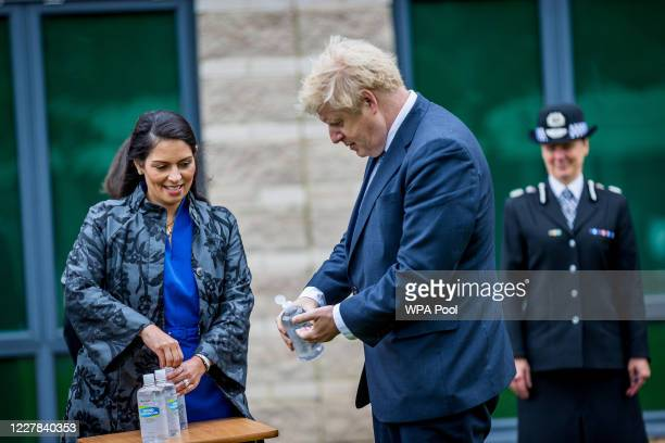Prime Minster Boris Johnson and Home Secretary Priti Patel sanitize theirs hands during a visit to The North Yorkshire police and are introduced to...