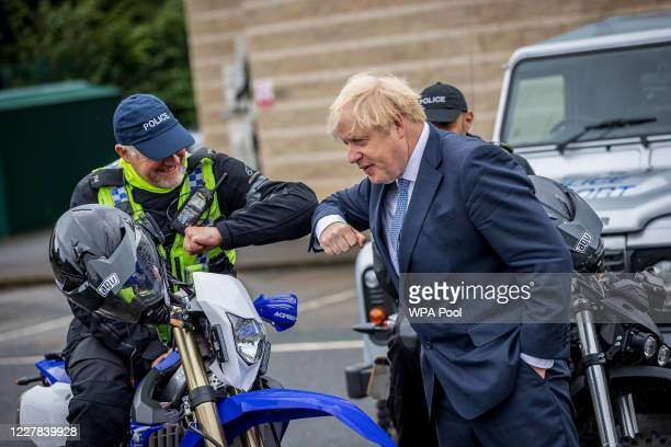 Prime Minster Boris Johnson does an elbow bump as he visits The police and is introduced to recently graduated Police Officers on July 30 2020 in...