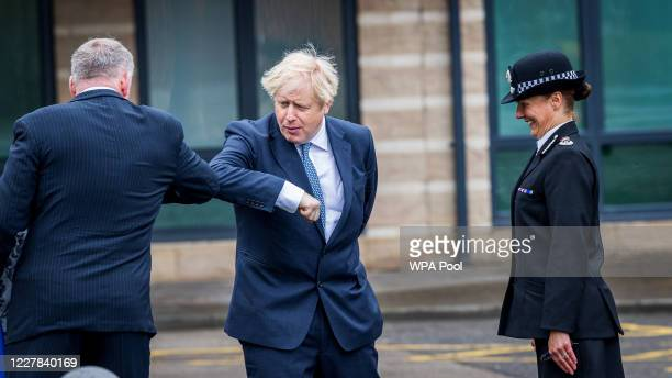 Prime Minster Boris Johnson does an elbow bump greeting as he visits The North Yorkshire police and is introduced to recently graduated Police...