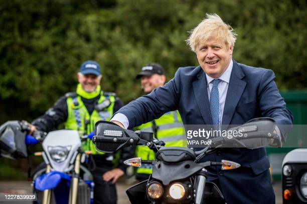 Prime Minster Boris Johnson tries out a North Yorkshire Police Rural Taskforce bike which is a Zero FX an Electric Bike as he and Home Secretary...