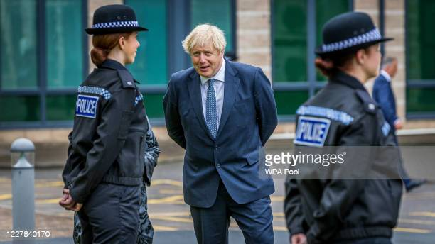 Prime Minster Boris Johnson visits The North Yorkshire police and is introduced to recently graduated Police Officers on July 30 2020 in...