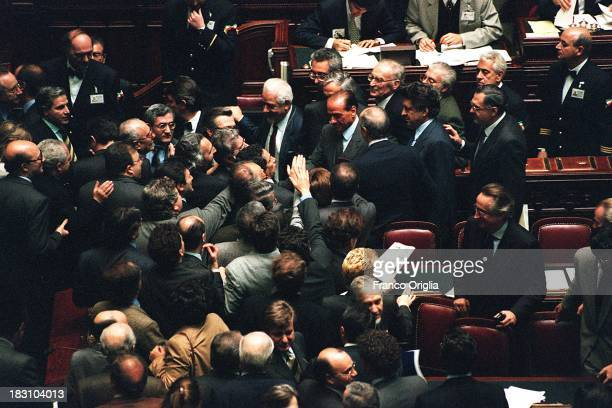 Prime Minster Silvio Berlusconi leaves the assembly at the Chamber of Deputies after a debate at Montecitorio on December 21 1994 in Rome Italy