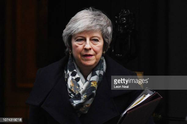 Prime Minster Theresa May leaves 10 Downing Street for the House of Commons on December 17 2018 in London England The UK political week picked up...