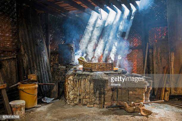 Primitive palm sugar factory boiling the collected sap near Pangandaran West Java Indonesia