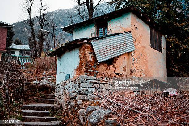 primitive residence on hill slope - merten snijders stock pictures, royalty-free photos & images