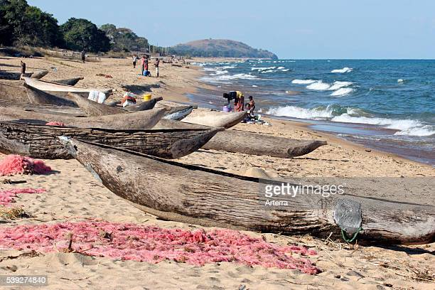 Primitive wooden fishing boats / proas and fishing nets on the beach Lake Malawi Malawi Africa