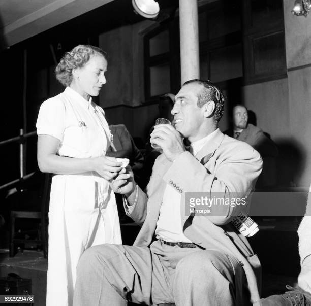 Primo Carnera actor and professional wrestler also a former professional boxer pictured during break from filming scenes for new film A Kid for Two...