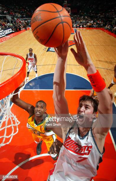Primoz Brezec of the Charlotte Bobcats goes up for a dunk against Jerome James of the Seattle SuperSonics on December 31, 2004 at the Charlotte...