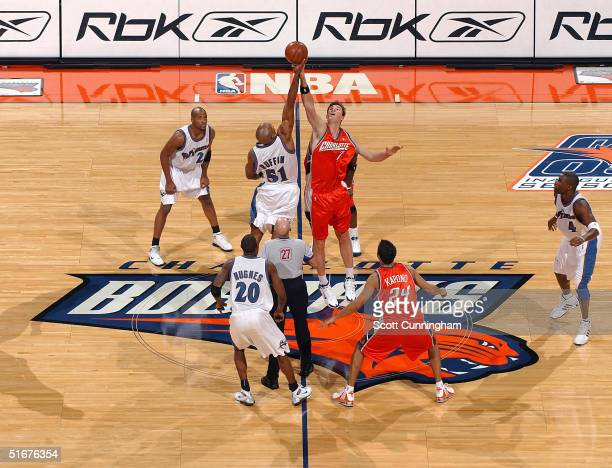 Primoz Brezec of the Charlotte Bobcats jumps for the season opening tip against Michael Ruffin of the Washington Wizards in a game on November 4 2004...